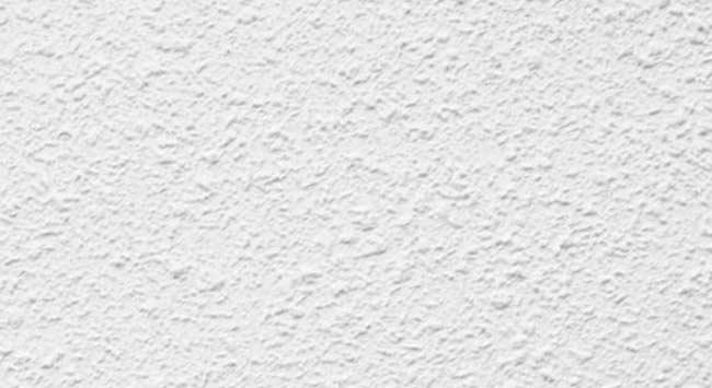 Spackspuitwerk op de muur