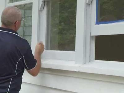 Houten ramen schilderen